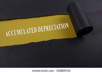 Accounting and finance concept, word accumulated depreciation on torn paper.