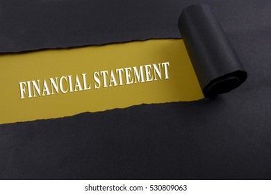 Accounting and finance concept, word financial statement on torn paper.