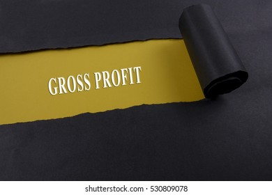 Accounting and finance concept, word gross margin on torn paper.