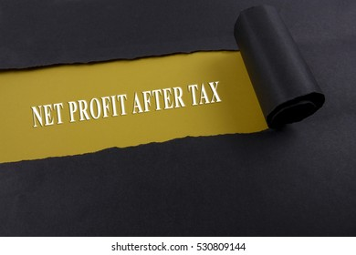 Accounting and finance concept, word net profit after tax on torn paper.
