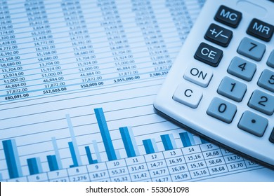 Accounting financial banking stock spreadsheet data numbers with calculator in blue. Financial concept.