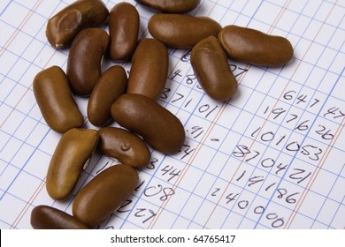 Accounting ledger book with a pile of beans.  Accounting theme.