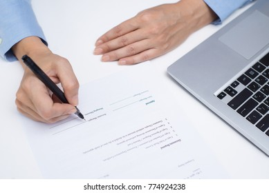 Accounting manager filling document at table