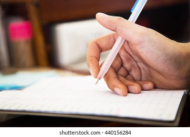 accounting with notebook, old style concept, vintage style concept.(focus at the hand)