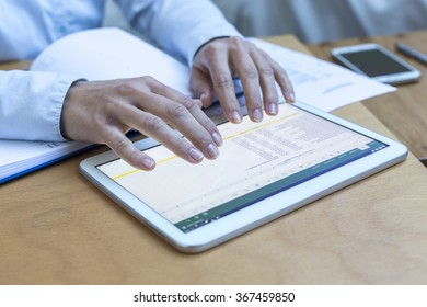 Accounting on a tablet computer, close-up