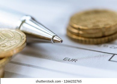 Accounting, pencil and coins
