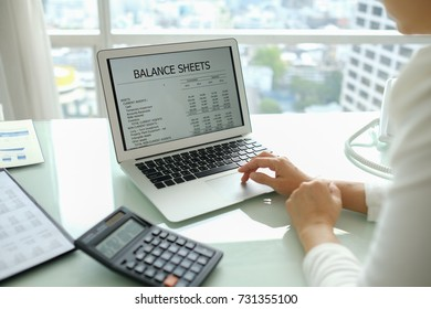accounting report spreadsheet. accountant women using computer prepare financial report.