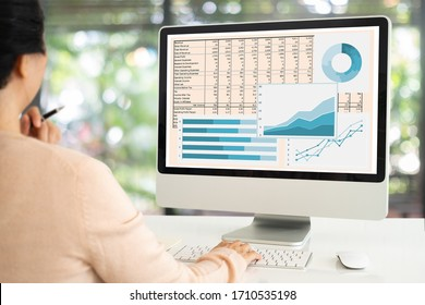 Accounting report spreadsheet.  women using computer prepare business report for evaluation performance.