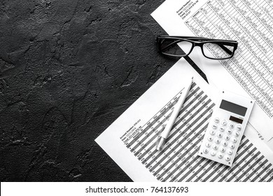 accounting work space with calculator, profit and tables on dark