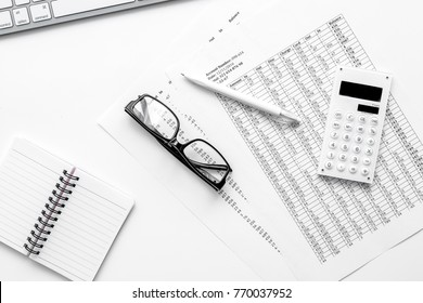 accounting work space with calculator, profit and tables on whit