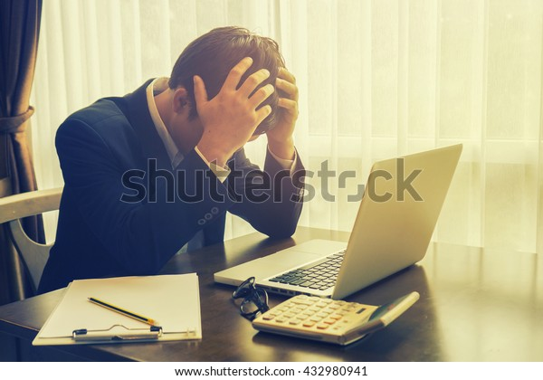 Accounting.Business  man ,Frustrated stressed business man in an office.selective focus,vintage color