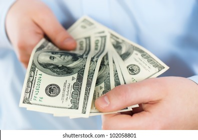 Accounting.Dollar in a man's hand on a white background