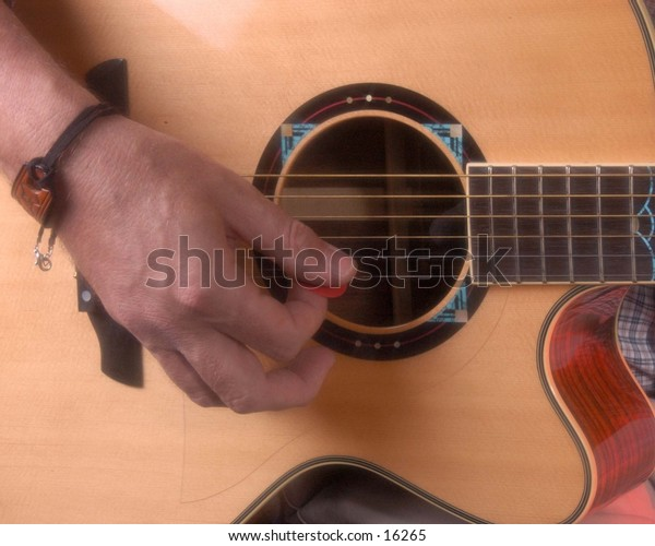 Accoustic Guitar and hand