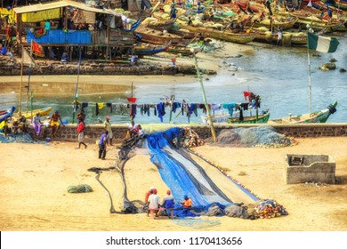 Accra, Ghana - 17 February 2016: Fishing village of Jamestown, a part of Accra the capitol of Ghana. Many huts, some fishing boats, a jetty and drying fish in this scene as shot from above.'