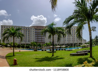 ACCRA, GHANA - APRIL 12 2018: Luxury Movenpick Ambassador Hotel in central Accra with its beautiful pool and gardens, perfect for relaxing