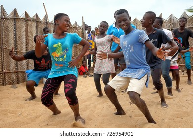 ACCRA - GHANA - AUGUST 17, 2017: Unidentified young dancers practice a traditional dance on the beach on August 17, 2017 in Accra, Ghana