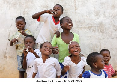 ACCRA - GHANA - AUGUST 19, 2017: Unidentified young happy singers practice a traditional dance in the streets of Accra on August 19, 2017 in Accra, Ghana