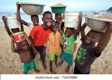ACCRA - GHANA - AUGUST 26, 2017: Unidentified children carry sand on the beach on August 26, 2017 in Accra, Ghana