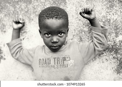 ACCRA - GHANA - AUGUST 28, 2017: Unidentified boy in a slum on August 28, 2017 in the fishing village Jamestown in Accra, Ghana