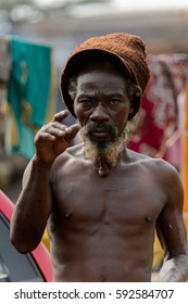 ACCRA, GHANA - Jan 8, 2017: Unidentified Ghanaian hippie man with beard stands at the local market. People of Ghana suffer of poverty due to the economic situation