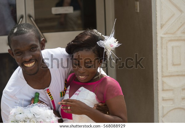 ACCRA, GHANA - JAN 8, 2017: Unidentified Ghanaian beautiful bride and groom on their wedding day. People of Ghana suffer of poverty due to the economic situation