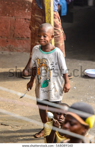 ACCRA, GHANA - JAN 8, 2017: Unidentified Ghanaian barefoot little boy in the street . Children of Ghana suffer of poverty due to the economic situation