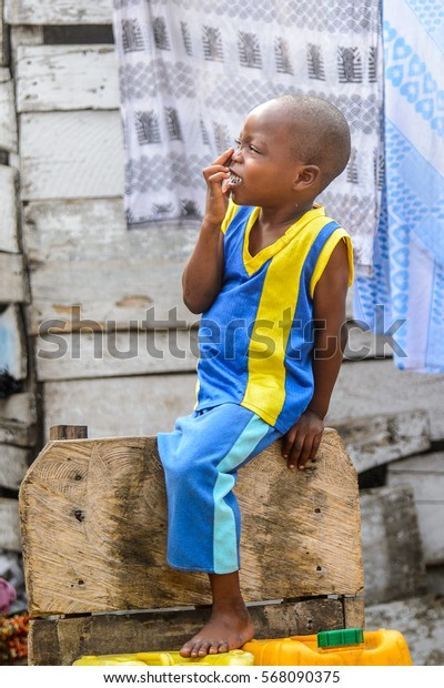 ACCRA, GHANA - JAN 8, 2017: Unidentified Ghanaian little boy puts his fingers on the face. Children of Ghana suffer of poverty due to the  difficult economic situation