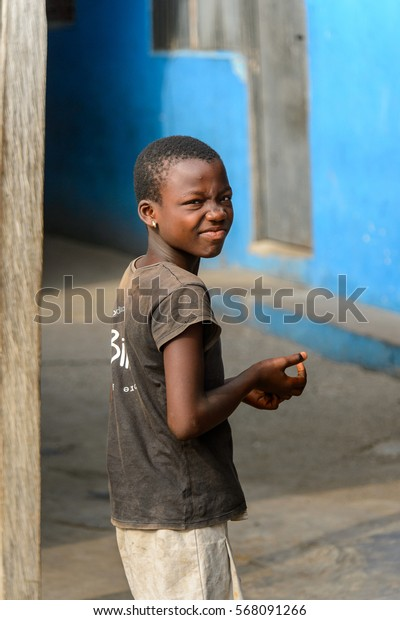 ACCRA, GHANA - JAN 8, 2017: Unidentified Ghanaian little girl grimaces for the camera. Children of Ghana suffer of poverty due to the economic situation