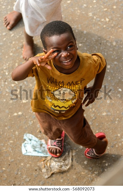 ACCRA, GHANA - JAN 8, 2017: Unidentified Ghanaian little boy play in the trash on the street. Children of Ghana suffer of poverty due to the economic situation