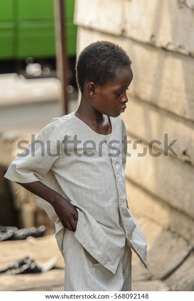 ACCRA, GHANA - JAN 8, 2017: Unidentified Ghanaian little boy holds a hand in his pocket. Children of Ghana suffer of poverty due to the economic situation