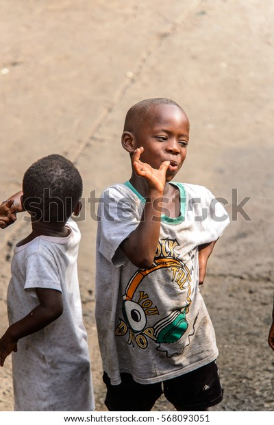 ACCRA, GHANA - JAN 8, 2017: Unidentified Ghanaian little boy puts his finger into the mouth. Children of Ghana suffer of poverty due to the economic situation