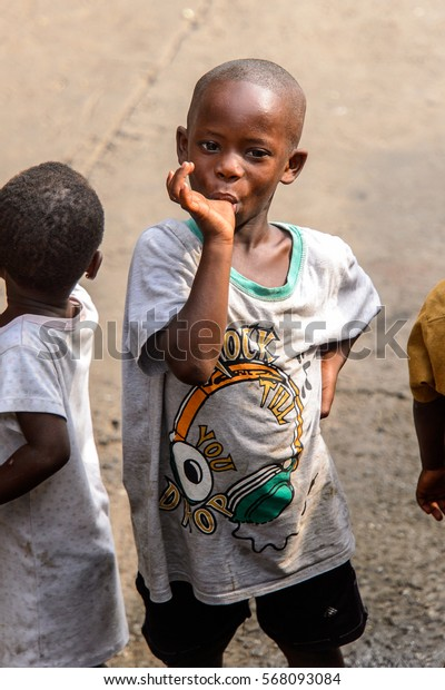 ACCRA, GHANA - JAN 8, 2017: Unidentified Ghanaian little boy sucks his thumb. Children of Ghana suffer of poverty due to the economic situation
