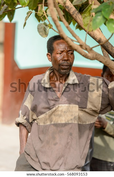 ACCRA, GHANA - JAN 8, 2017: Unidentified Ghanaian man in old dirty clothes on the street. People of Ghana suffer of poverty due to the economic situation