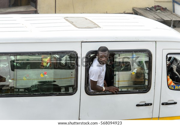 ACCRA, GHANA - JAN 8, 2017: Unidentified Ghanaian man looks out of car window. People of Ghana suffer of poverty due to the economic situation