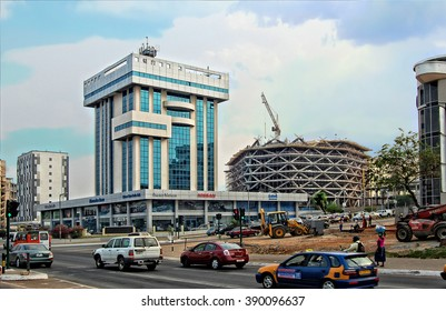 ACCRA, GHANA -JAN 9,2014: Development of city infrastructure in Africa. Construction, building frame, scaffolding, new shopping mall. Economic growth in West Africa. Urban sprawl Construction industry