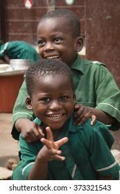 ACCRA, GHANA - JANUARY 2016: School children in front of their school in Jamestown, Accra, Ghana