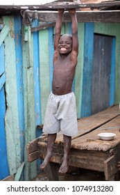 ACCRA - GHANA - JULY 25, 2017: Unidentified happy boy in a slum on July 25, 2017 in the fishing village Jamestown in Accra, Ghana