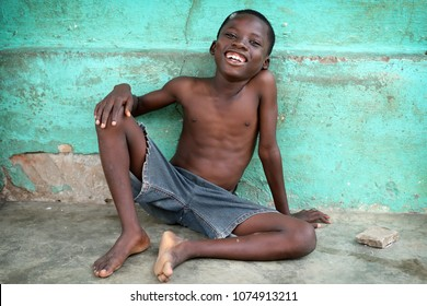 ACCRA - GHANA - JULY 26, 2017: Unidentified happy boy in a slum on July 26, 2017 in the fishing village Jamestown in Accra, Ghana