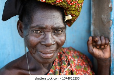 ACCRA - GHANA - JULY 29, 2017: Unidentified market woman with traditional dress on July 29, 2017 in Accra, Ghana