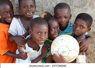 ACCRA - GHANA - JULY 29, 2017: Unidentified boys pose with a soccer ball in a primary school of a fishing village on July 29, 2017 near Accra, Ghana
