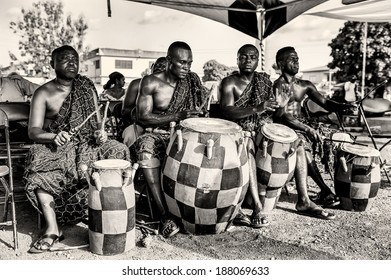 ACCRA, GHANA - MAR 3, 2012: Unidentified Ghanaian local musicians hit the drums in the street. Music is one of the main kinds of entertainment in Africa