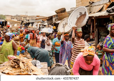 ACCRA, GHANA - MARCH 4, 2012: Unidentified Ghanaian people at the market in Ghana. People of Ghana suffer of poverty due to the unstable economic situation