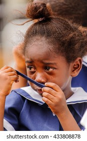 ACCRA, GHANA - MARCH 4, 2012: Unidentified Ghanaian girl cries in a school uniform in Ghana. School uniform is a part of the humanitarian help to Africa from the others countries