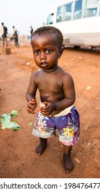 ACCRA, GHANA - MARCH 5, 2012: Unidentified Ghanaian scred boy in the street in Ghana. Children of Ghana suffer of poverty due to the unstable economic situation