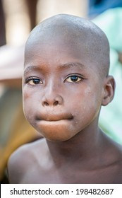ACCRA, GHANA - MARCH 6, 2012: Unidentified Ghanaian boy in the street in Ghana. Children of Ghana suffer of poverty due to the unstable economic situation