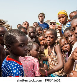 ACCRA, GHANA - MARCH 6, 2012: Unidentified Ghanaian children crowd in the street in Ghana. Children of Ghana suffer of poverty due to the unstable economic situation