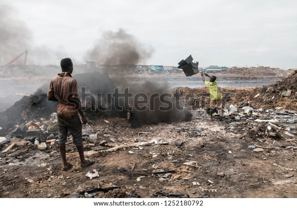 Accra, Ghana - March/April 2016  Worker in the dump of Agbogbloshie