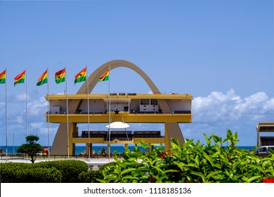 ACCRA,GHANA - APRIL 11 2018: Black Star Square. Independence Arch and flags of Ghana in Accra's Independence Square, site of Independence Day parades and national celebrations