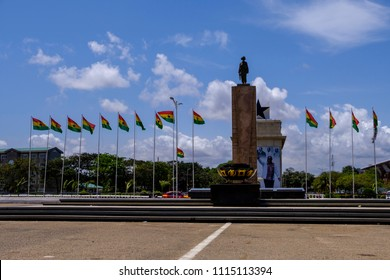 ACCRA,GHANA - APRIL 11 2018: Statue of soldier and flags of Ghana in Accra's Independence Square, venue for Independence day parades and national celebrations