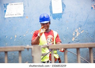 ACCRA,GHANA- FEBRUARY 12, 2019: Electrical constructor poses at the camera on long day in sunny Accra